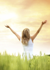 Picture of Woman in field with arms up iStock_000016725022_Large