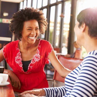 Wellness Coach talking at a coffee shop